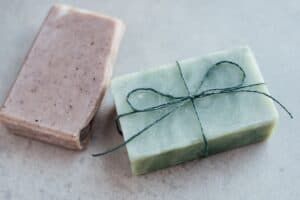 two bars of soap, one wrapped in twine