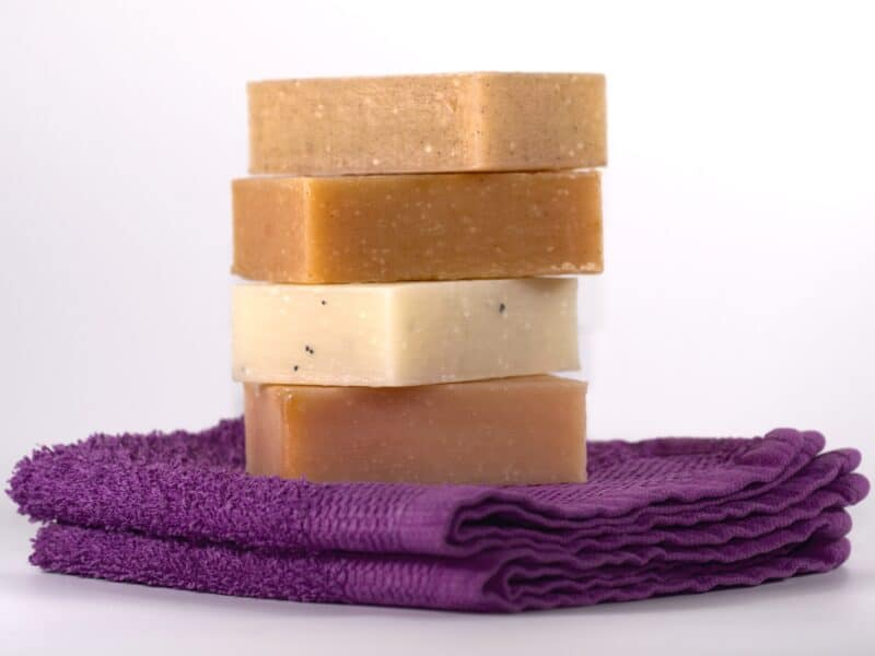 stack of bar soaps on purple towel