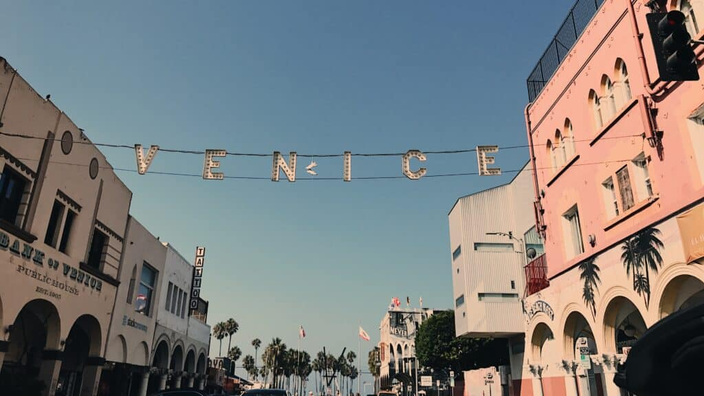 """sign above the street that says """"Venice"""""""