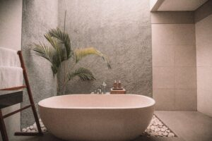 bath against rock wall with palm tree