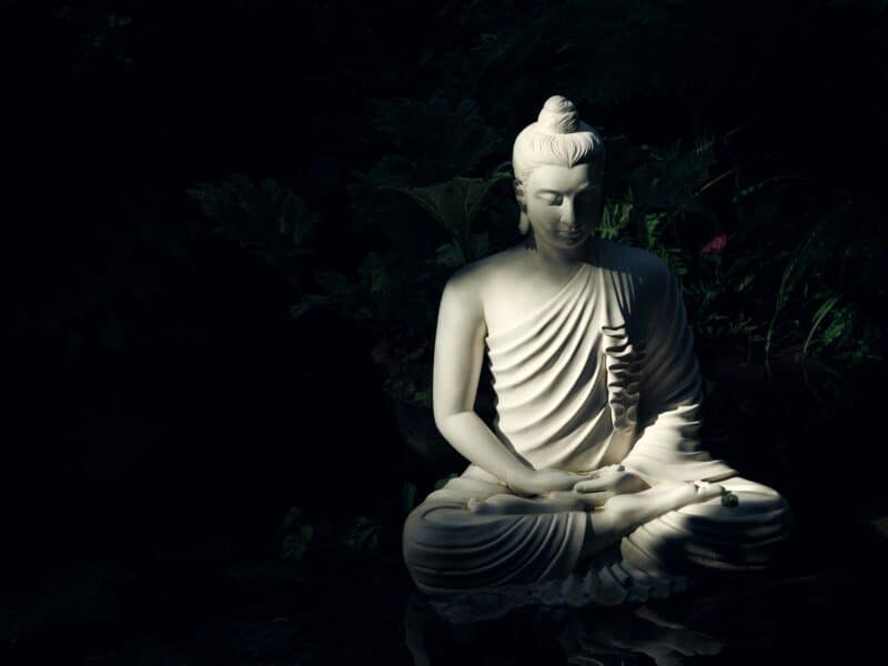 black background with grey buddha statue
