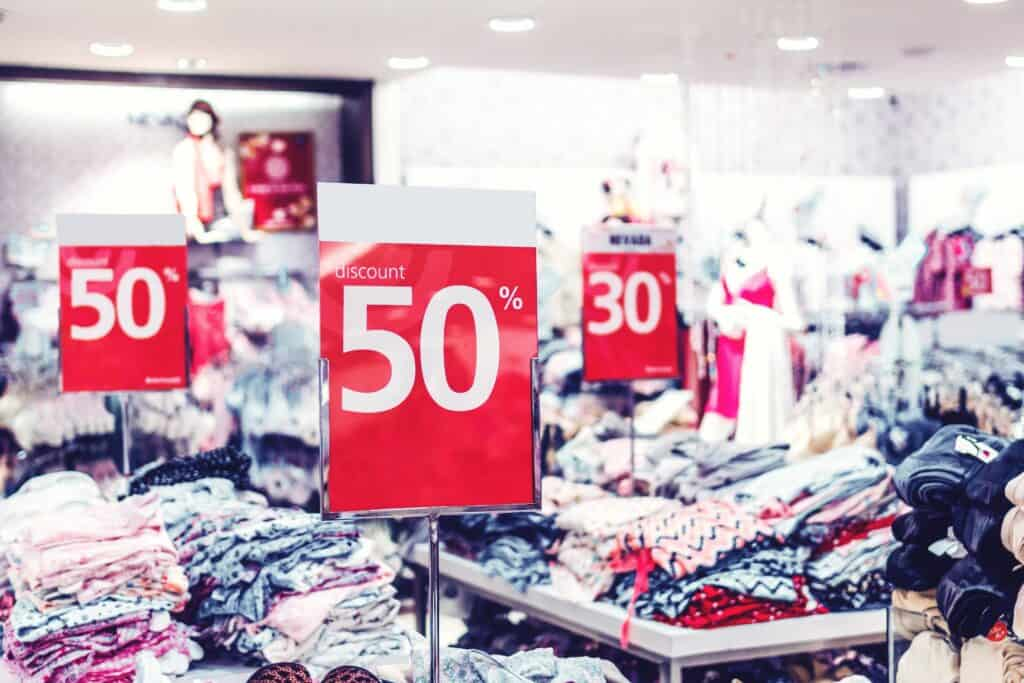 store full of clothes and sale signs