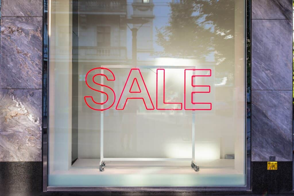 red sale sign on store window