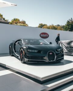 black bugatti chiron on white platform