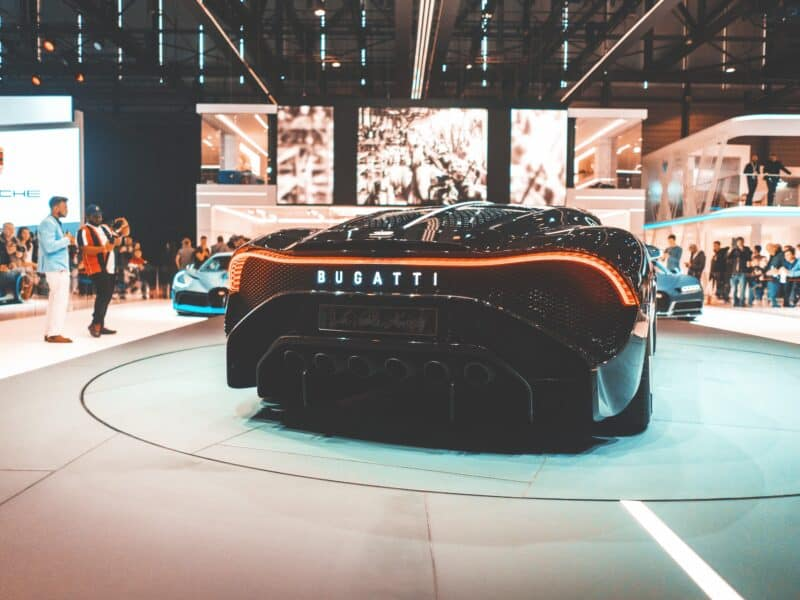 back of black bugatti on showroom floor