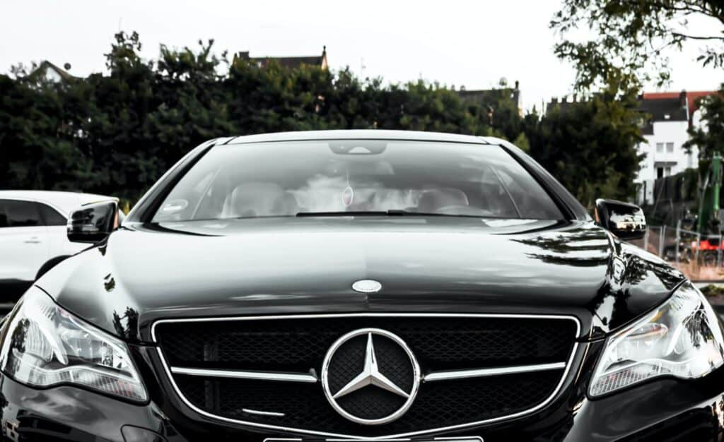 front of black mercedes