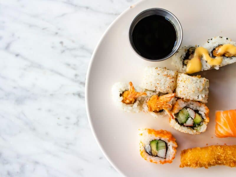 white plate with sushi and soy sauce