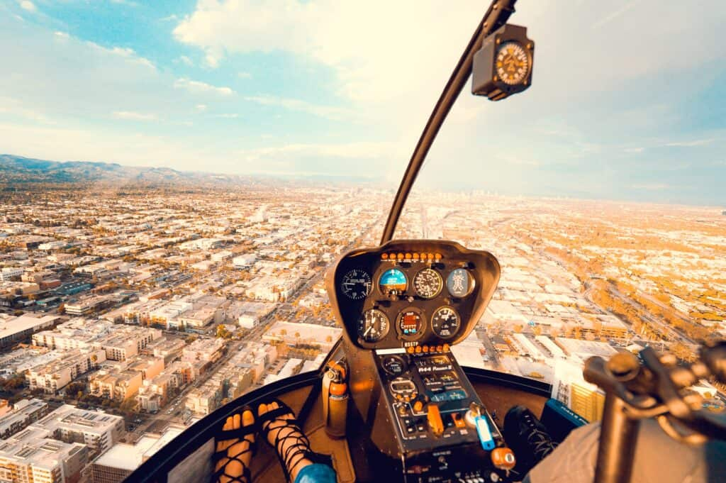 inside of helicopter overlooking the city