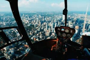 inside of helicopter overlooking city