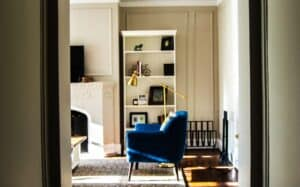 blue chair with brass lamp in living room