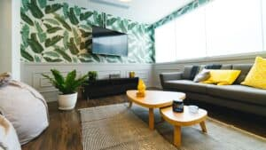 living room with palm leaf wallpaper