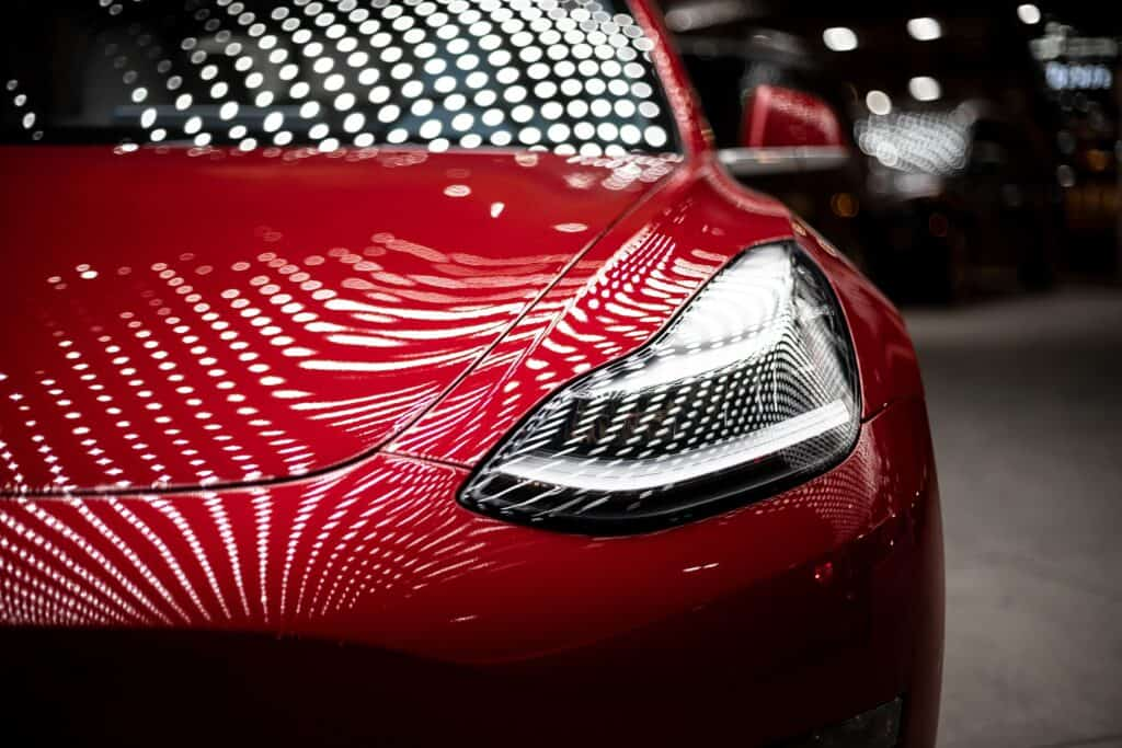 close up of red tesla
