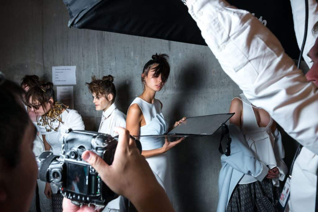 view of model and photographers