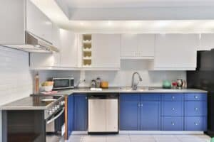 two tone kitchen with bright blue and white cabinet