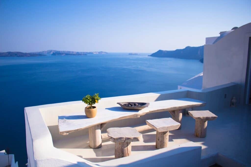 balcony with two seats overlooking ocean