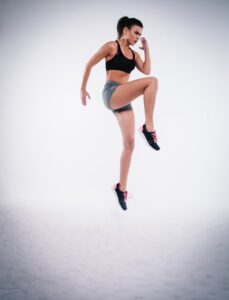 girl working out, jumping in air
