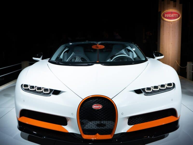 White and orange bugatti veyron on showroom floor