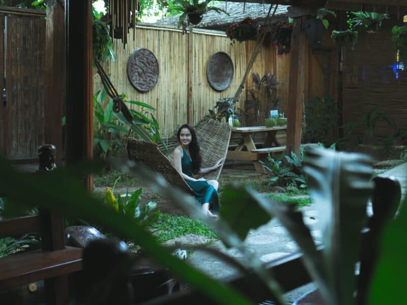 girl sitting in tropical back yard