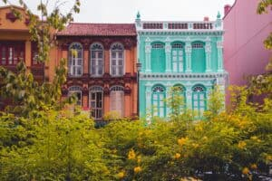 bright blue, pink, and orange classical town homes