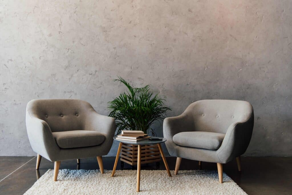 shot of two grey chairs and a green plant