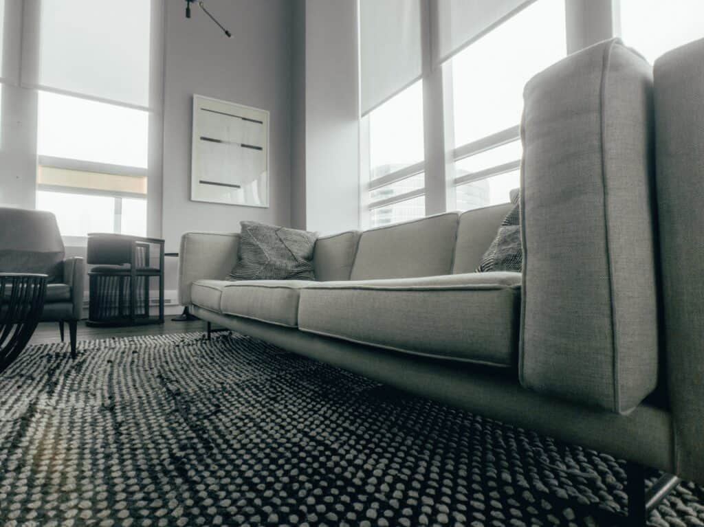 view of grey couch and grey living room from floor angle