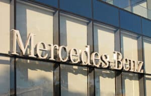 mercedes-benz logo on outside of building