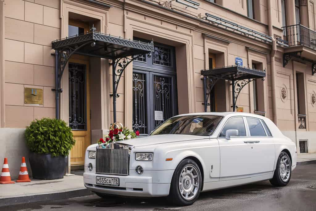 white rolls royce phantom parked on street