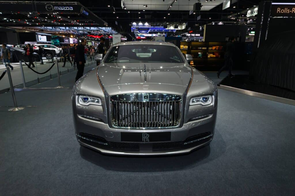 gray rolls royce phantom on showroom floort