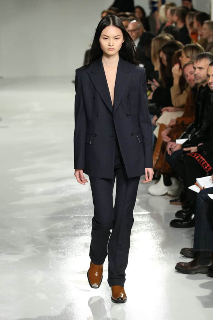 Calvin Klein female model walks runway