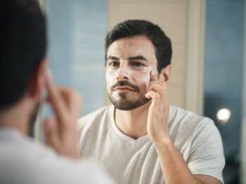 man applying face cream