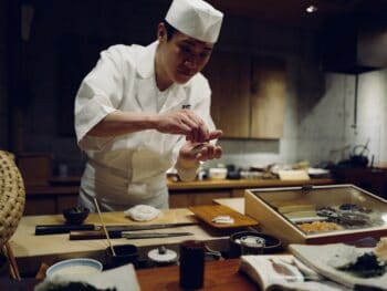 sushi chef preparing meal
