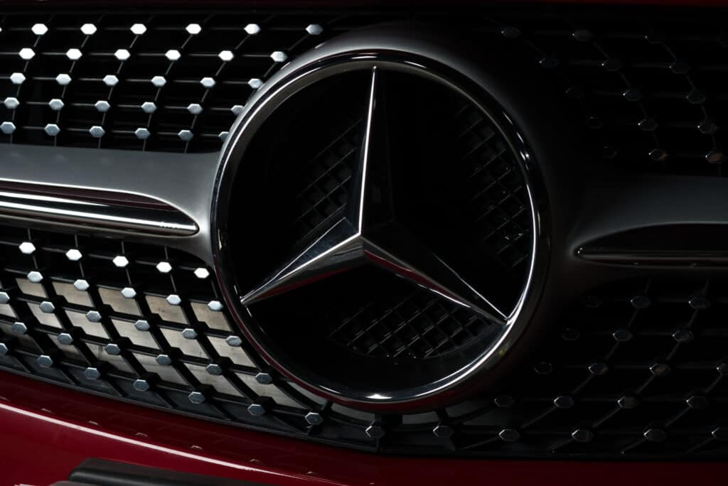 close up of black mercedes logo