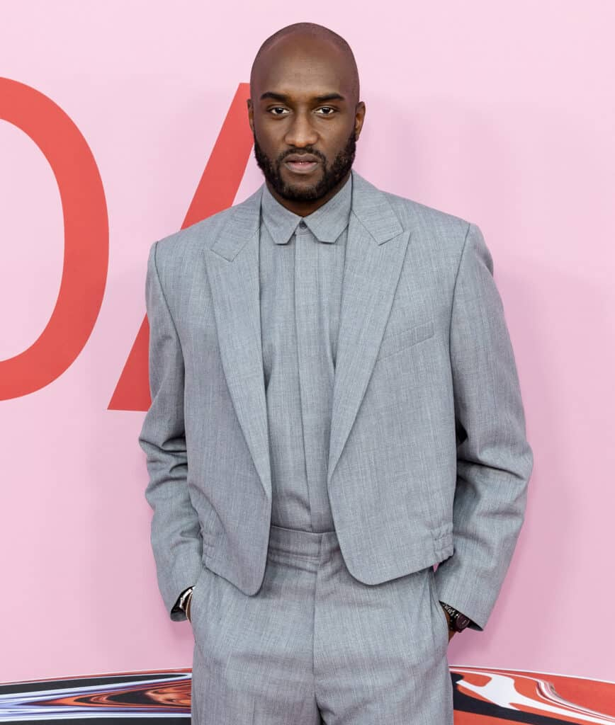 designer, Virgil Abloh, standing against pink wall