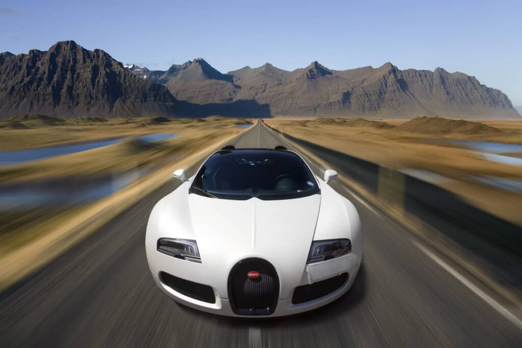 white bugatti driving down desert highway