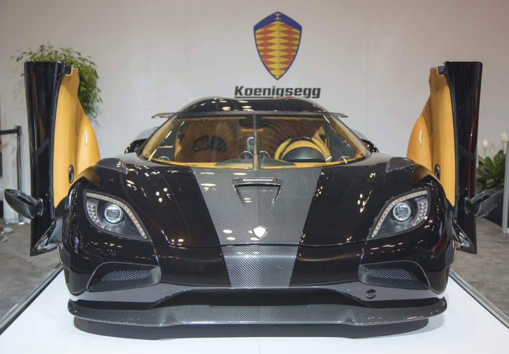 black koenigsegg on showroom floor