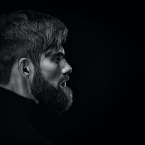 black and white photo of man with beard