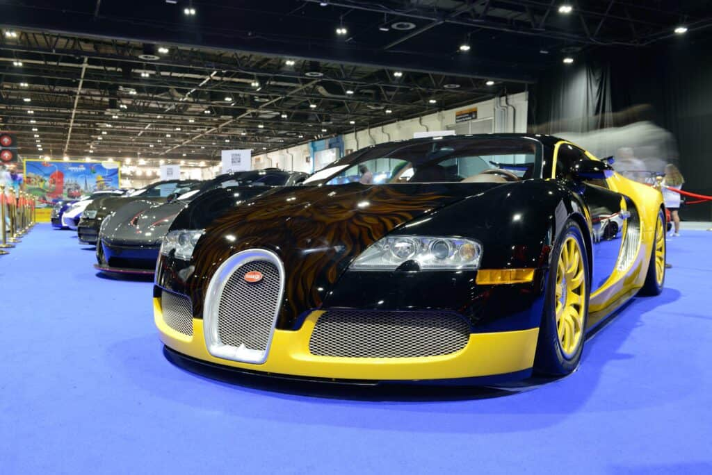 black and yellow bugatti on showroom floor