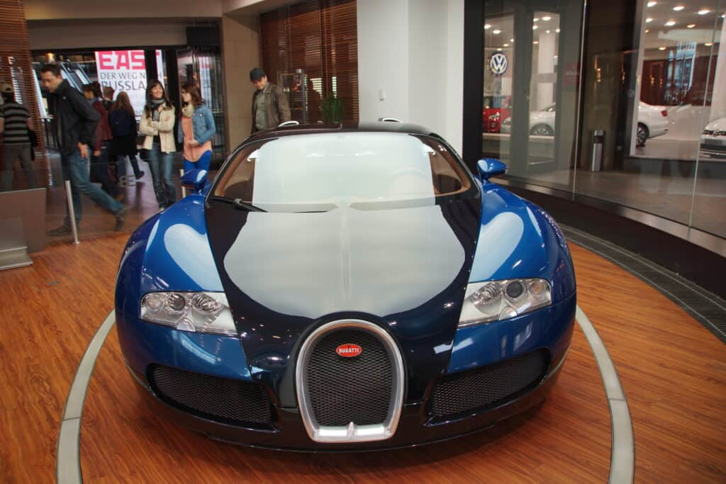 black and blue bugatti on showroom floor