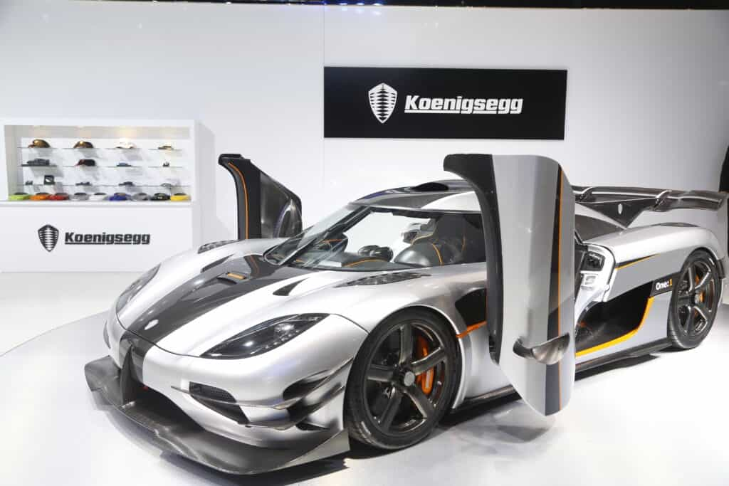 Silver Koenigsegg on showroom floor