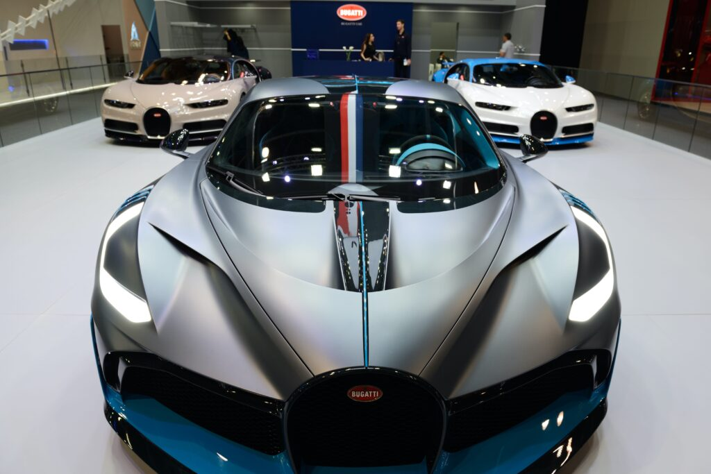 Silver Bugatti on showroom floor