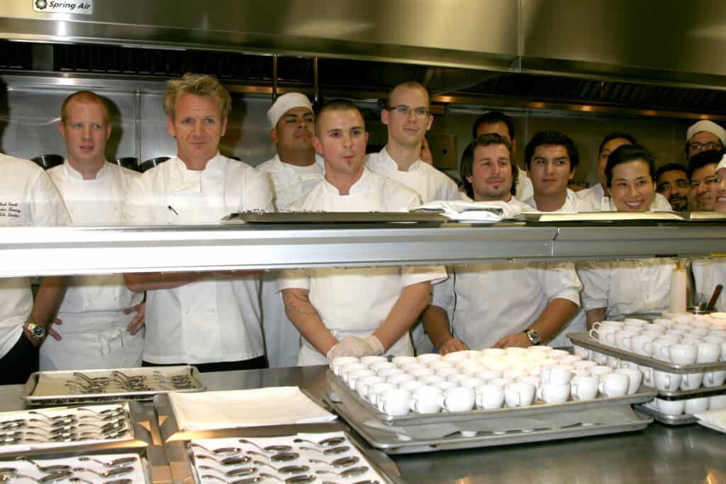 Gordon Ramsay and his staff standing in kitchen
