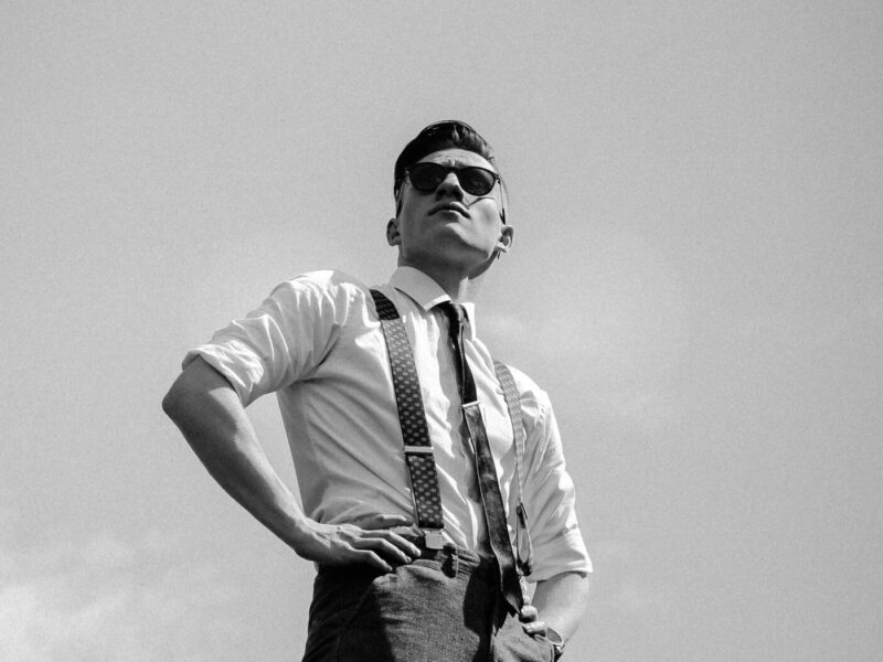 man in suspenders wearing sunglasses