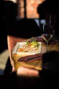 dim lit restaurant with plate of food on table