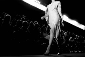 black and white photo of model on runway