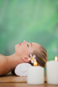 women laying head on pillow at the spa
