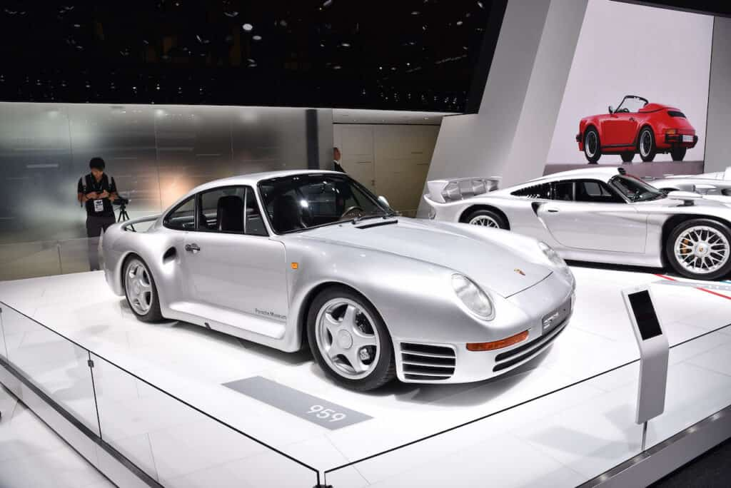 silver Porsche 959 on showroom floor