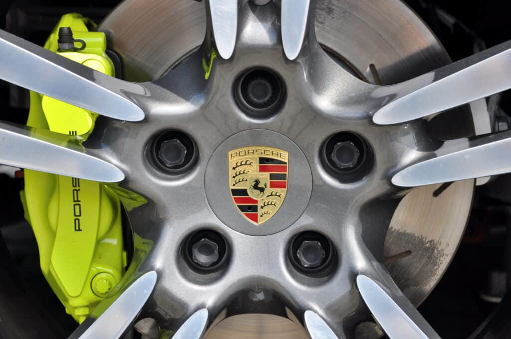 close up photo of Porsche car wheel