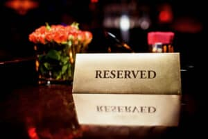 Reserved sign sitting on table