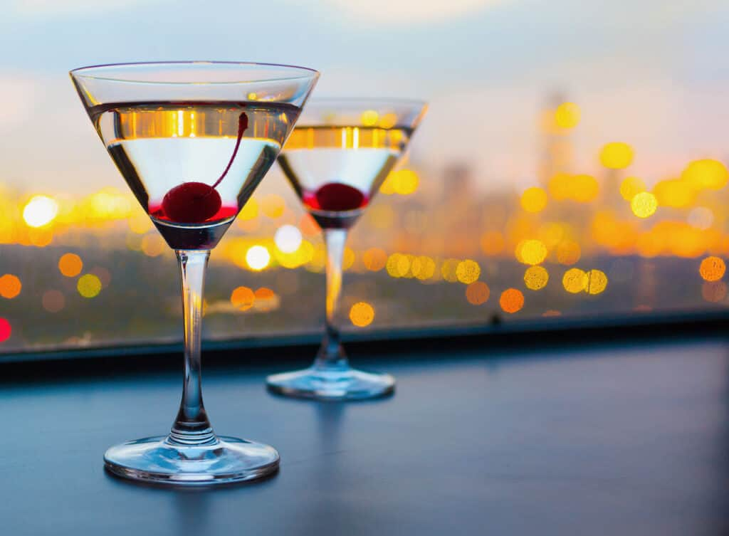 Two martinis sitting on table