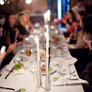 shot of dining table with people seated